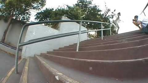Corey Duffel backside tailslide 13 stair rail 2003 | Corey Duffel