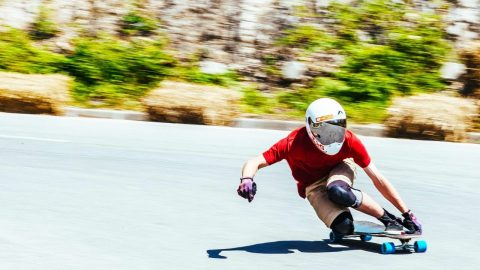 POV Downhill Longboarding with a Twist: No Hands Allowed | Red Bull No Paws Down - Red Bull